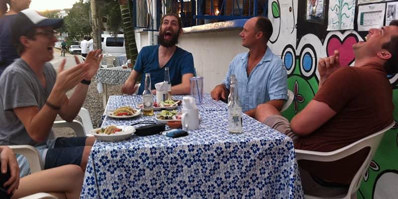 A laugh over tacos on a men's retreat